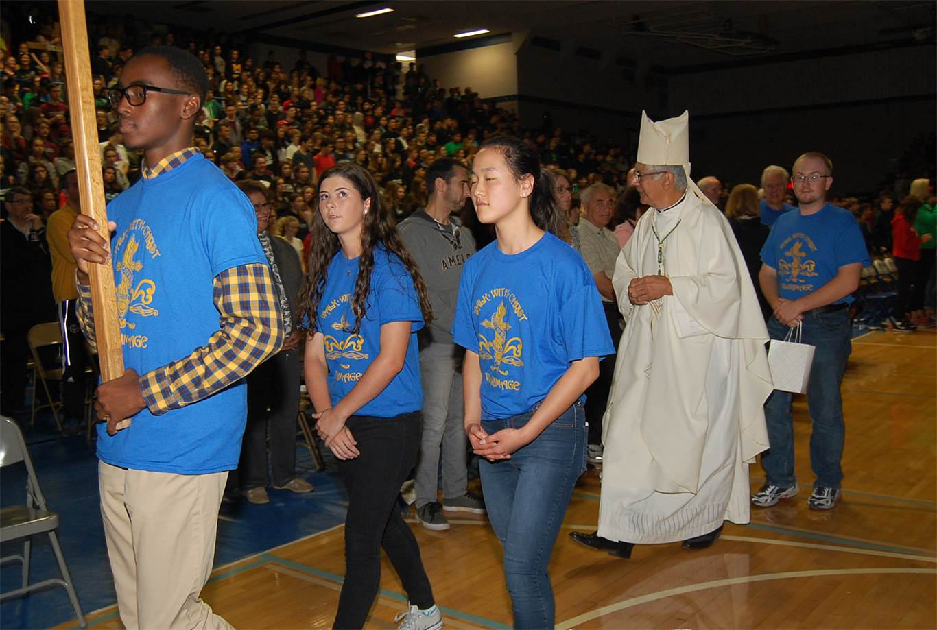 3,000 students and staff fill the gymnasium, cafeteria and forum at Cathedral High School for a pre-pilgrimage mass on Oct. 15.
